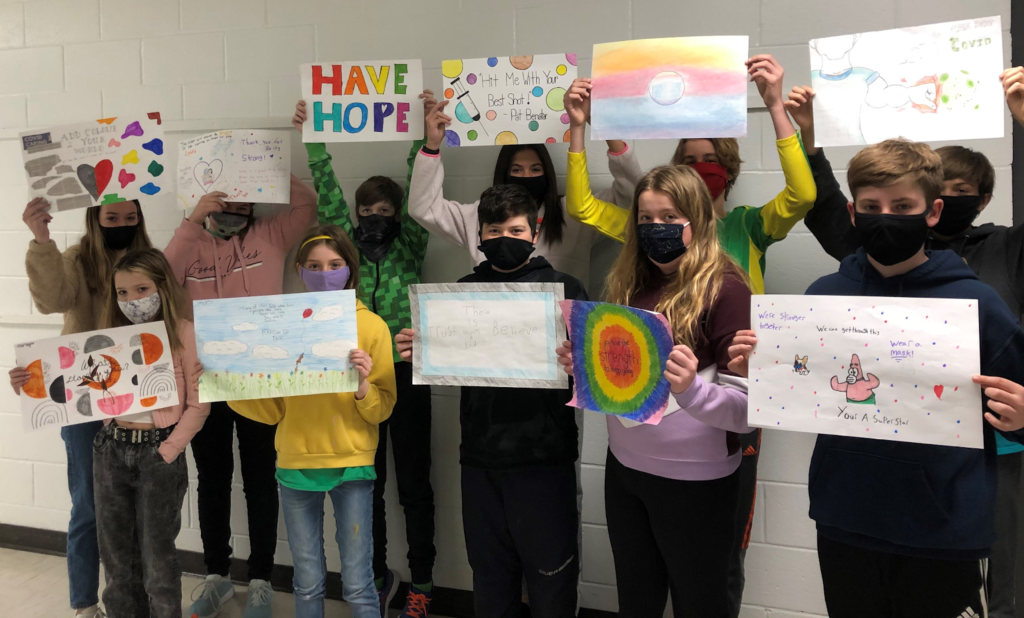 Students create artwork to adorn the walls of the mass vaccination centre in Point Edward.